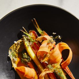 Baby Carrots with Carrot-Top Pipián, Pistachio, and Coriander
